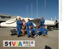 Graham Hawkes and his team beside the Deep Flight Challenger