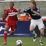 The Chicago Fire's Mike Banner, left, fights for the ball in a file photo from last year