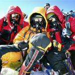 A photo from Team Romero showing, from left, Paul Romero, Jordan Romero and Karen Lundgren on the summit of Mount Everest in May.  Three Sherpa guides were also among the group