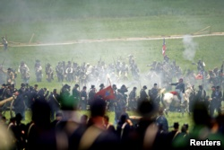 Actors reenact Pickett's Charge during the 150th anniversary of the Battle of Gettysburg.