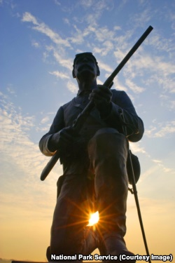 The bronze likeness of a Union trooper, carbine at the ready, sits atop the monument to the 1st Pennsylvania Cavalry.