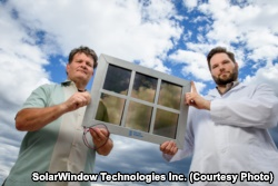 John Conklin (left) and Scott Hammond of SolarWindow Technologies Inc. with their transparent solar cell