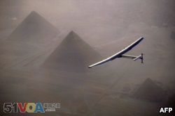This handout photo released by Solar Impulse 2 shows the solar powered plane, piloted by Swiss pioneer Andr<I>&amp;#</I>233; Borschberg, during the flyover of the pyramids of Giza on July 13, 2016 prior to landing in Cairo, Egypt.