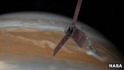 This artist's rendering shows NASA's Juno spacecraft making one of its close passes over Jupiter.