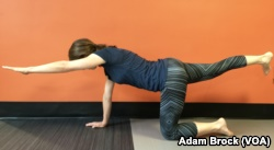 This exercise, called the Quadruped, targets your core.