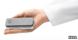 The MinION (aka Biomolecule Sequencer), a miniaturized DNA sequencer, by Oxford Nanopore Technologies.