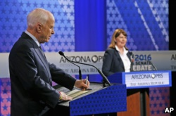 Sen. John McCain, left, debates Rep. Ann Kirkpatrick during recent Senate debate.