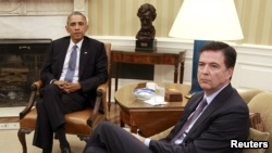 U.S. President Barack Obama (L) sits with FBI Director James Comey in the Oval Office in Washington after making comments to the media about shootings at military facilities in Chattanooga, Tennessee, July 16, 2015.