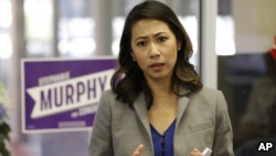 In this photo taken Oct. 18, 2016, Florida Democratic Congressional candidate Stephanie Murphy meets with voters at a senior center in Altamonte Springs, Florida. Murphy went on to become the first Vietnamese-American woman to be elected to Congress.
