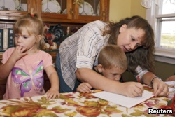 This mother in Iowa is homeschooling her children. To