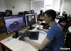 FILE - Programmer of Game Stream company, branch of Wargaming, Andrey Safronov, works on a computer in Minsk, Belarus, March 18, 2016.