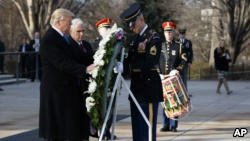President-elect Donald Trump places a wreath at the Tomb of the Unknowns, Thursday, Jan. 19, 2017, at Arlington National Cemetery in Arlington, Va., ahead of Friday's presidential inauguration. (AP Photo/Evan Vucci)