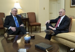 Senate Majority Leader Mitch McConnell meets Andy Puzder (right) before Puzder withdrew Wednesday as President Trump's labor secretary nominee.