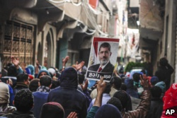 Supporters of ousted Islamist President Mohamed Morsi march in 2016. Morsi represented the Muslim Brotherhood, which was banned by Egypt's current government.